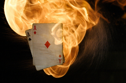 Ace of spades and diamonds engulfed in fire